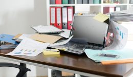 Untidy and cluttered desk